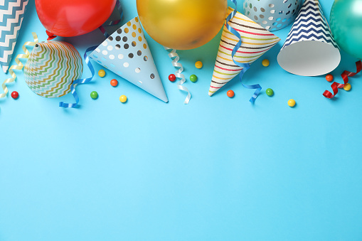 Composition with different birthday accessories on blue background, space for text 1200276925
