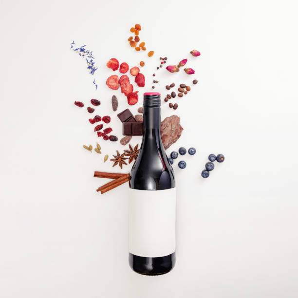 Composition with wine bottle and possible flavors of red wine