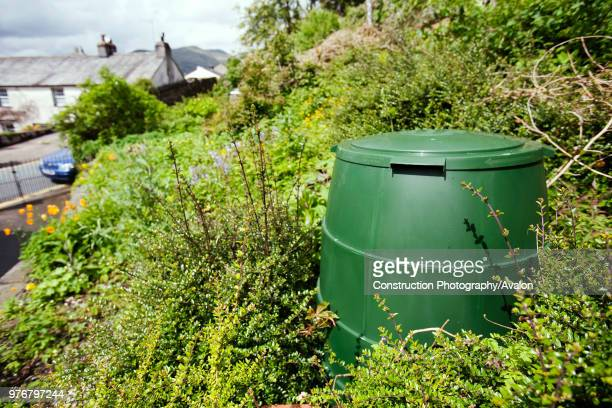 A compost bin in a garden in Ambleside Lake District UK Composting your green waste prevents grennhouse gas emissions as food waste in landfill...