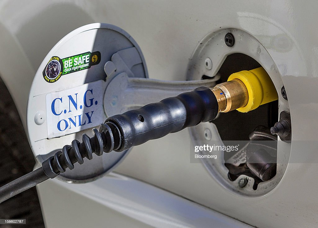 A compressed natural gas (CNG) pump fuels the Chevrolet Suburban sport utility vehicle (SUV) of Roger Plank, co-president and chief corporate officer of Apache Corp., in Houston, Texas, U.S., on Monday, Dec. 17, 2012. Apache Corp. is a gas exploration and production company with operations around the world, including the U.S., U.K., Canada and Argentina. Photographer: Craig Hartley/Bloomberg via Getty Images