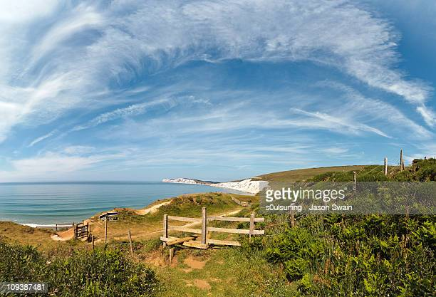 compton bay coastal path cirrus cloud panorama - isle of wight stock pictures, royalty-free photos & images