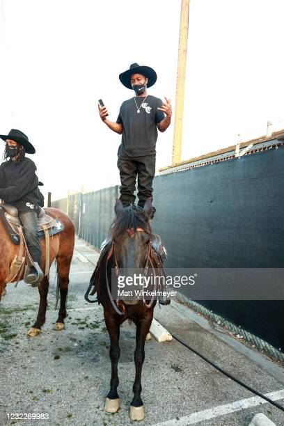 """Compton Cowboys on horseback are seen during Amazon Studios' """"Them"""" Drive-in Special Screening on April 08, 2021 in Compton, California."""
