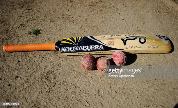 Compton Homies bat and balls lie on the cricket grounds during a training session with his Compton Homies and Popz cricket teammates at Woodley...