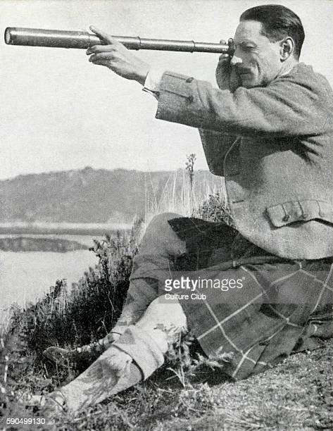 Compton Mackenzie, writer, cultural commentator, raconteur, Scottish nationalist, shown looking through a telescope, wearing kilt. 17 January 1883 -...