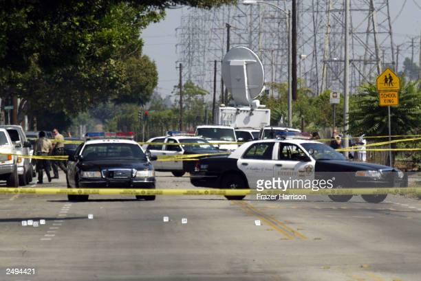 Compton Sheriff officers are shown at the crime scene where 31yearold Yetunde Price the older sister of tennis stars Venus and Serena Williams was...