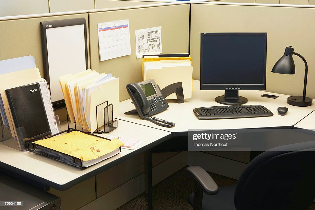 Computer and landline phone in office, elevated view : Stock Photo