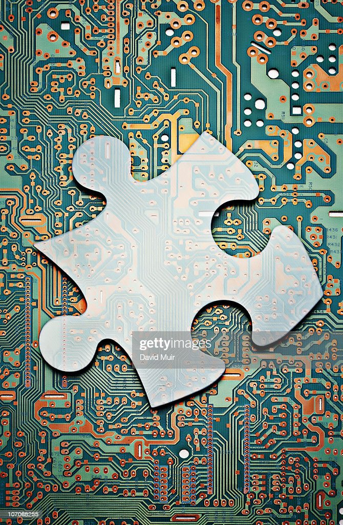 computer circuit board and puzzle piece stock photo getty imagescomputer circuit board and puzzle piece stock photo