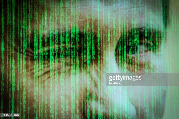 Computer code is seen with a portrait of Russian president Vladimir Putin in this photo illustration on October 31 2017 Material posted on Facebok...