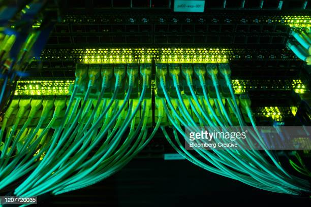 computer fibre optic network cables - computer cable stock pictures, royalty-free photos & images