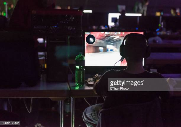computer game players at lan party /counterstrike tournament - esport stock pictures, royalty-free photos & images
