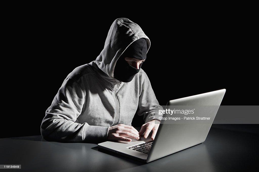 A computer hacker : Stock Photo