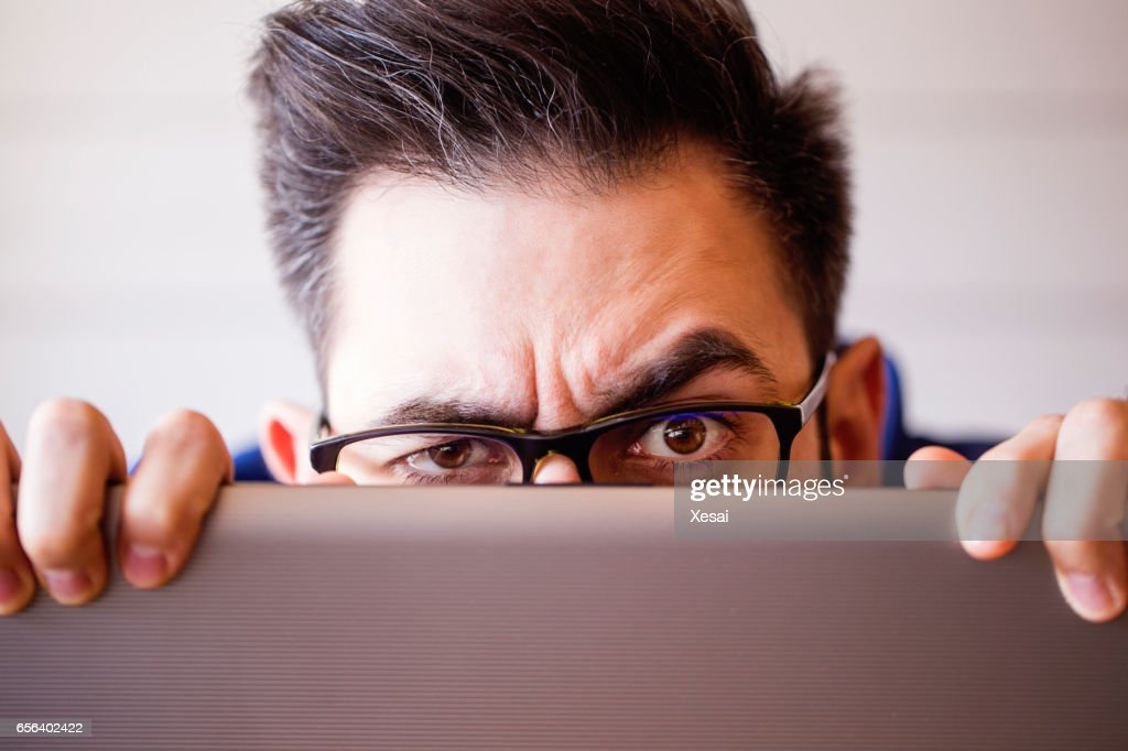 Computer hacker stealing information with laptop : Stock Photo
