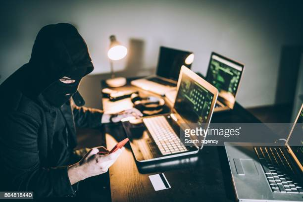 Computer hacker using phone