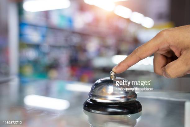 computer hardware stores have bell with hand. - request stock pictures, royalty-free photos & images
