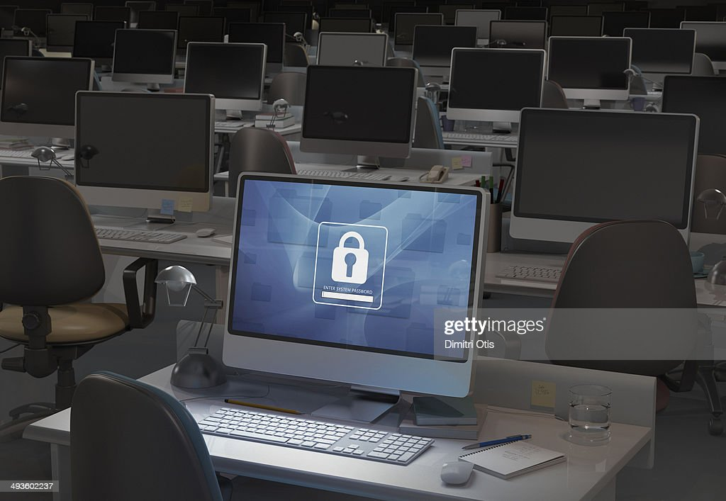 Computer in dark office, password entry required : Stock Photo