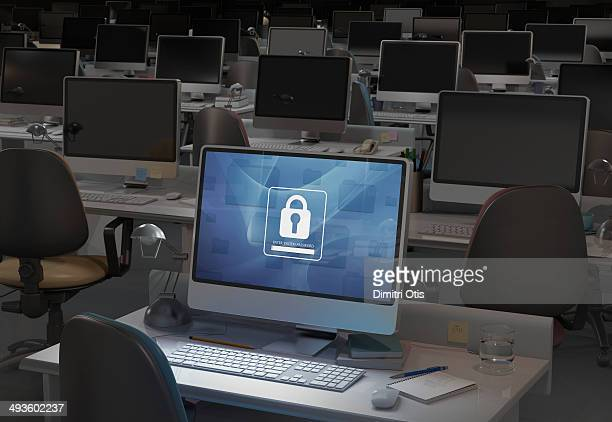 Computer in dark office, password entry required
