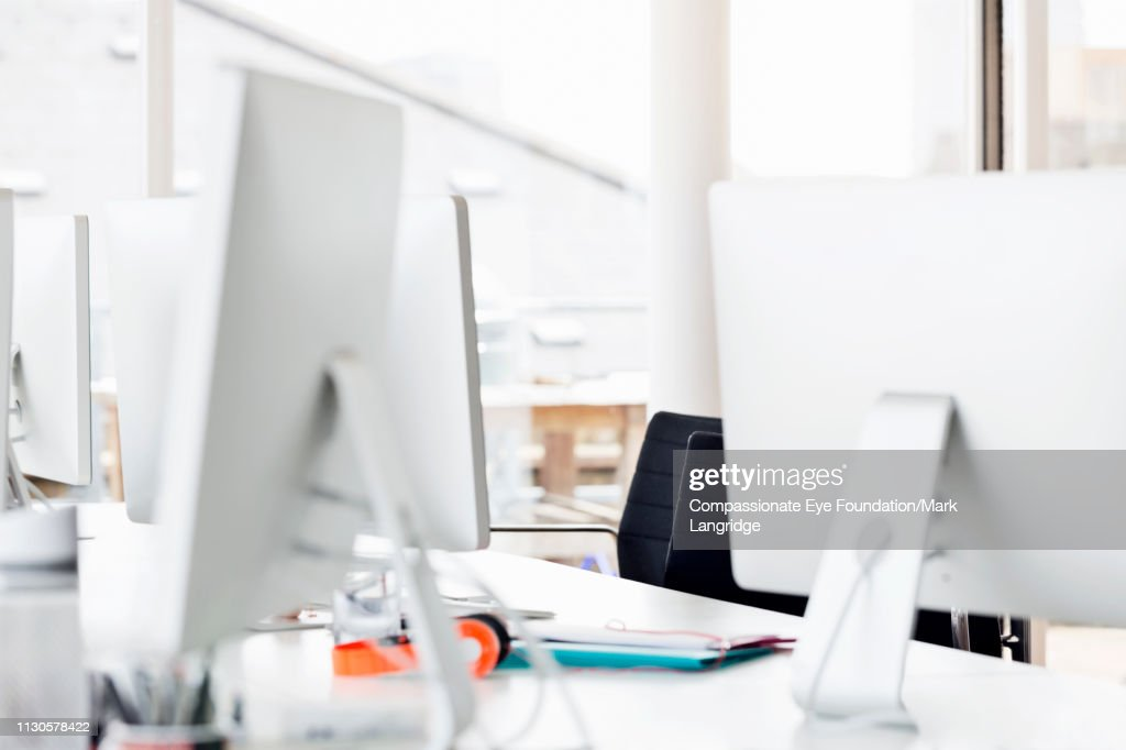 Computer in empty office : Stock Photo