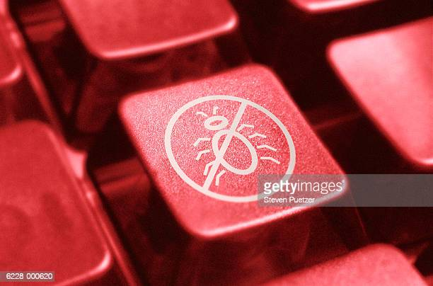 computer key with icon showing red line through ?bug' - computer bug stock photos and pictures