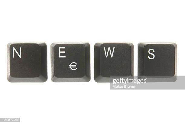computer keyboard keys spelling the word news - captions stock photos and pictures