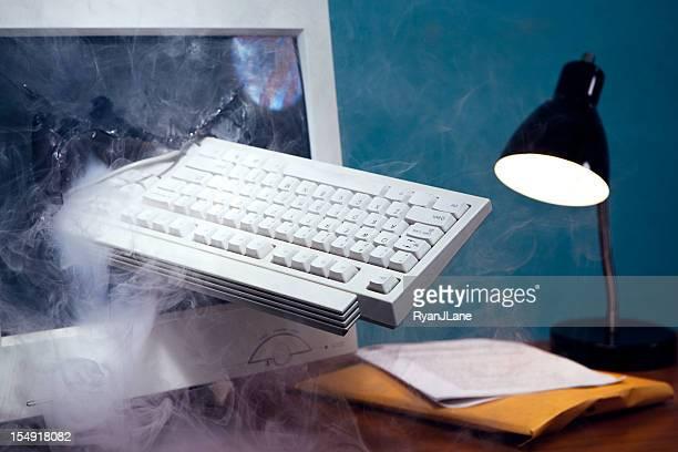 Computer Keyboard Smashed Through Monitor