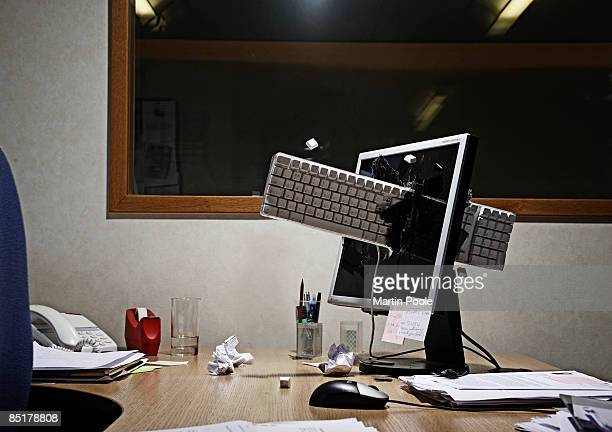 computer keyboard smashed through screen - destruction stock pictures, royalty-free photos & images