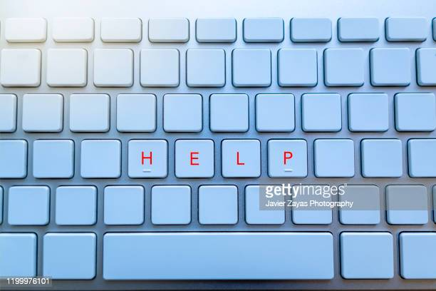 computer keyboard with empty keys all but four - help single word stock pictures, royalty-free photos & images