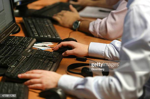 Computer keyboards and screens used for trading on the financial markets are seen on a trader's desk at the offices of Futex Co in Woking UK on...
