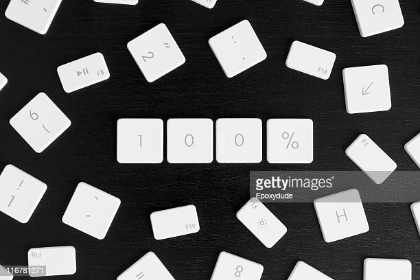 Computer keys arranged to read 100%