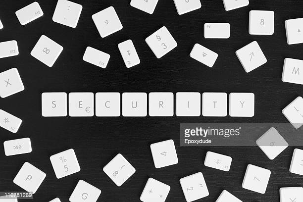 computer keys spelling security - computer key stock pictures, royalty-free photos & images