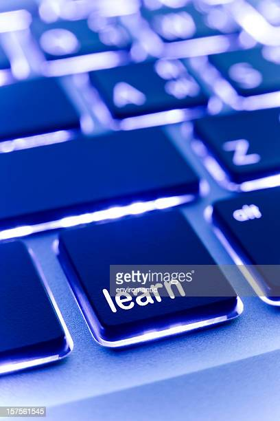 Computer laptop keypad 'learn' button.