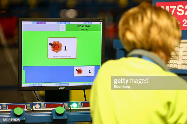 A computer monitor instructs an employee on which products to pick at the Ocado Group Plc distribution centre in Dordon UK on Friday Dec 16 2016...
