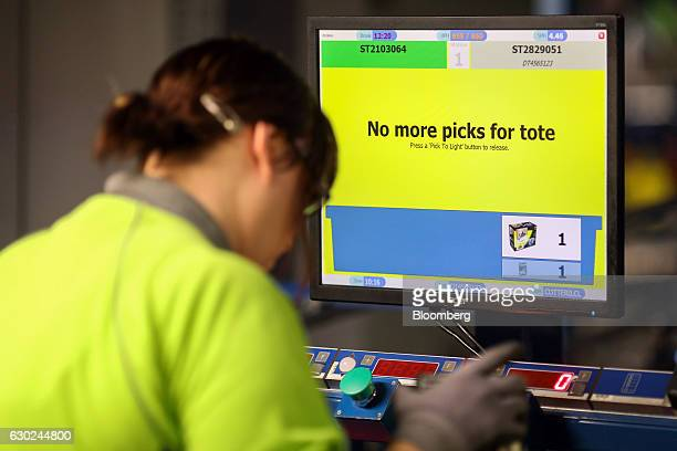 A computer monitor instructs an employee to pick no more products at the Ocado Group Plc distribution centre in Dordon UK on Friday Dec 16 2016 Ocado...