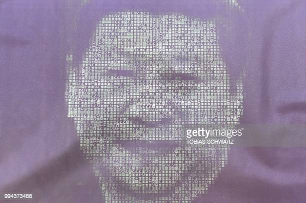 A computer monitor with the portrait of Chinese President Xi Jinping is pictured during a demonstration of activists of the 'Society for Threatened...