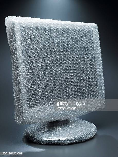 Computer monitor wrapped in air cellular cushioning material