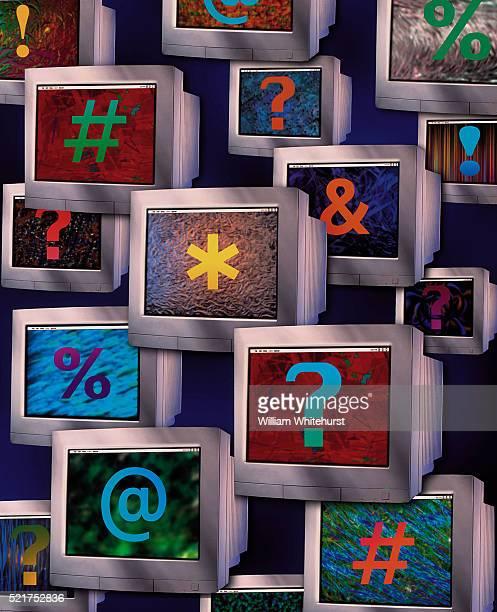 Computer Monitors Displaying Variety of Symbols