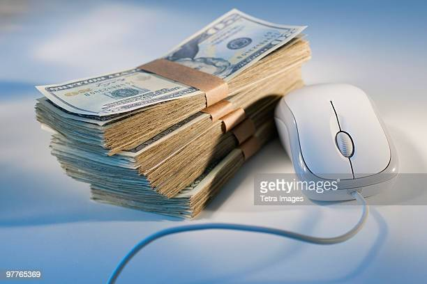 Computer mouse beside money