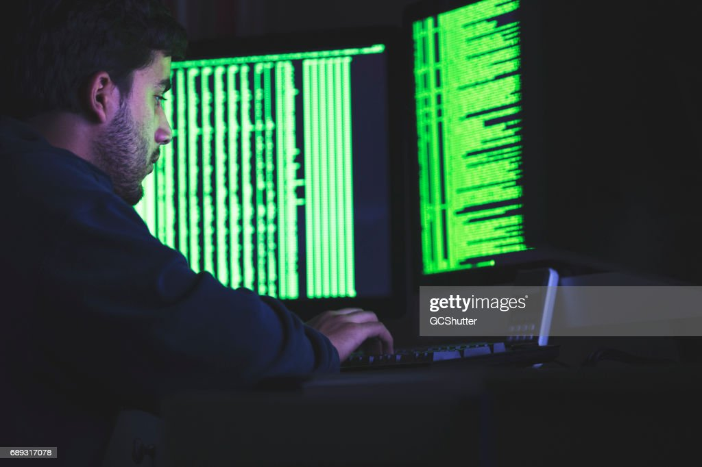 Computer nerd working late on his complex computer algorithms : Stock Photo