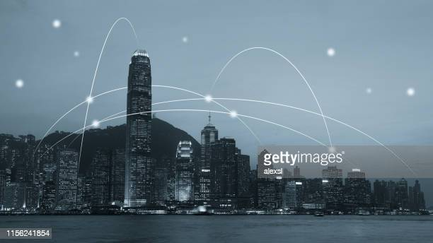 computer network connection modern city future internet technology - financial technology stock photos and pictures