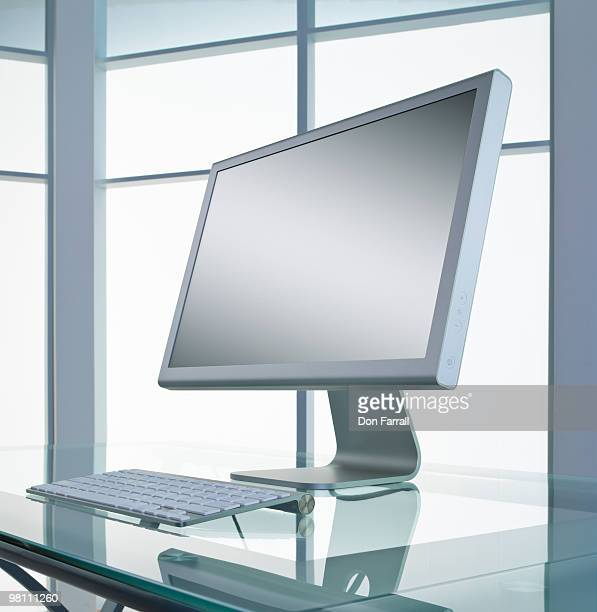 Computer on a glass desk