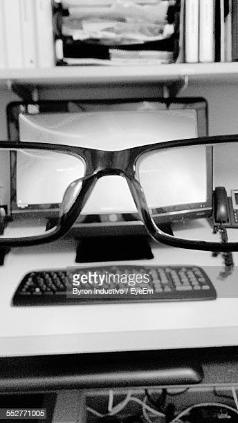 Computer On Desk Seen Through Eyeglasses At Home