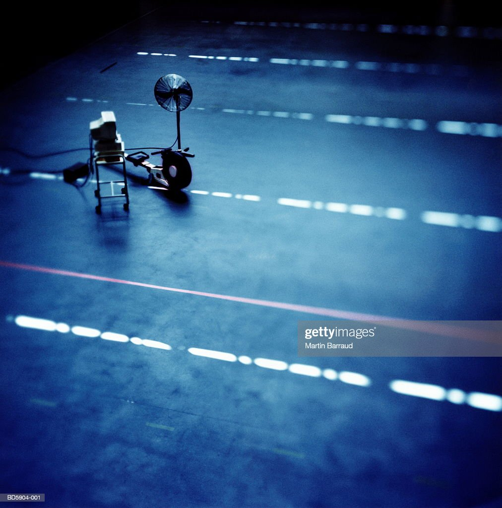 Computer on trolley, rowing machine and fan, elevated view : Stock Photo