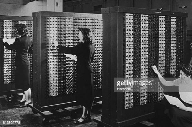 Computer operators program ENIAC the first electronic digital computer by adjusting rows of switches