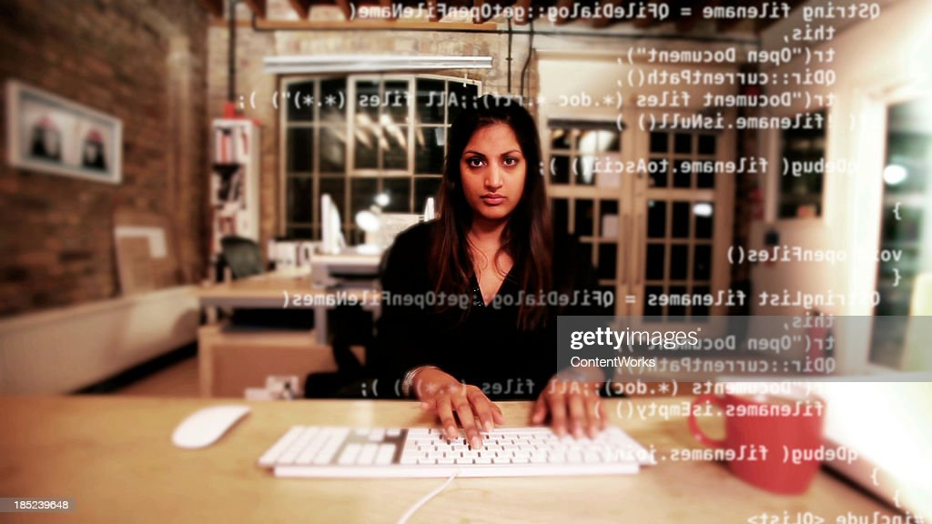 Computer programmer typing code : Stock Photo