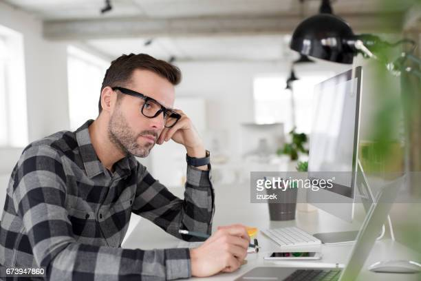 computer programmer working in an office - izusek stock pictures, royalty-free photos & images