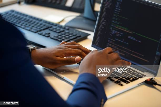 computer programmer working on laptop - coding stock pictures, royalty-free photos & images