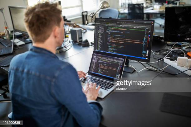 computer programmer working on new software program - development stock pictures, royalty-free photos & images
