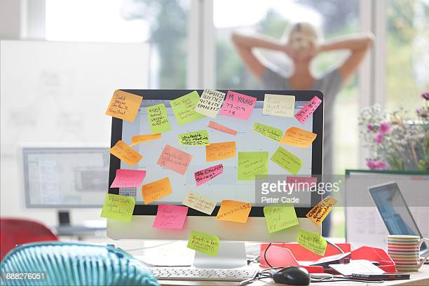 computer screen covered in sticky notes - overworked stock pictures, royalty-free photos & images