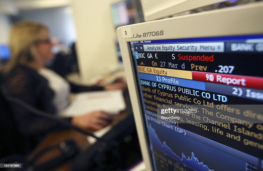 A computer screen displays company information and share price movements for Bank of Cyprus Plc at Shore Capital Group Ltd. brokerage in London, U.K., on Thursday, March 28, 2013. Cyprus's banks opened for the first time in almost two weeks, with new rules curbing access to cash preventing an initial panic to withdraw deposits. Photographer: Chris Ratcliffe/Bloomberg via Getty Images