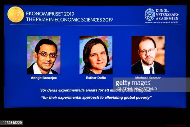 A computer screen displays the cowinners of the 2019 Sveriges Riksbank Prize in Economic Sciences in Memory of Alfred Nobel Abhijit Banerjee Esther...