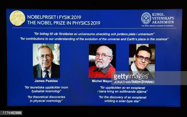Computer screen displays the portraits of the laureates of the 2019 Nobel Prize in Physics Canadian-American James Peebles, Swiss scientists Michel...